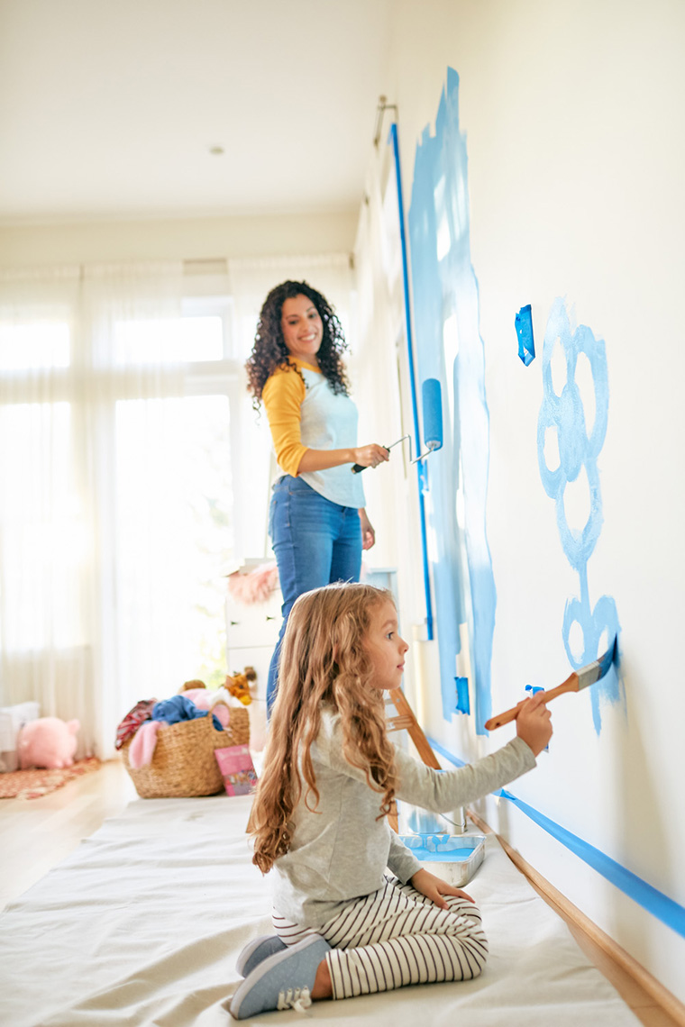 A mom and daughter paint a bedroom in this lifestyle photo by Leah Verwey