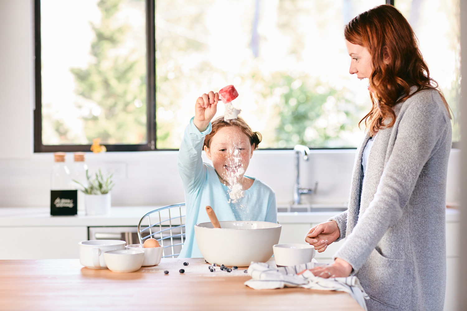 Lifestyle image of a mother and daughter in the kitchen in Portland, Oregon