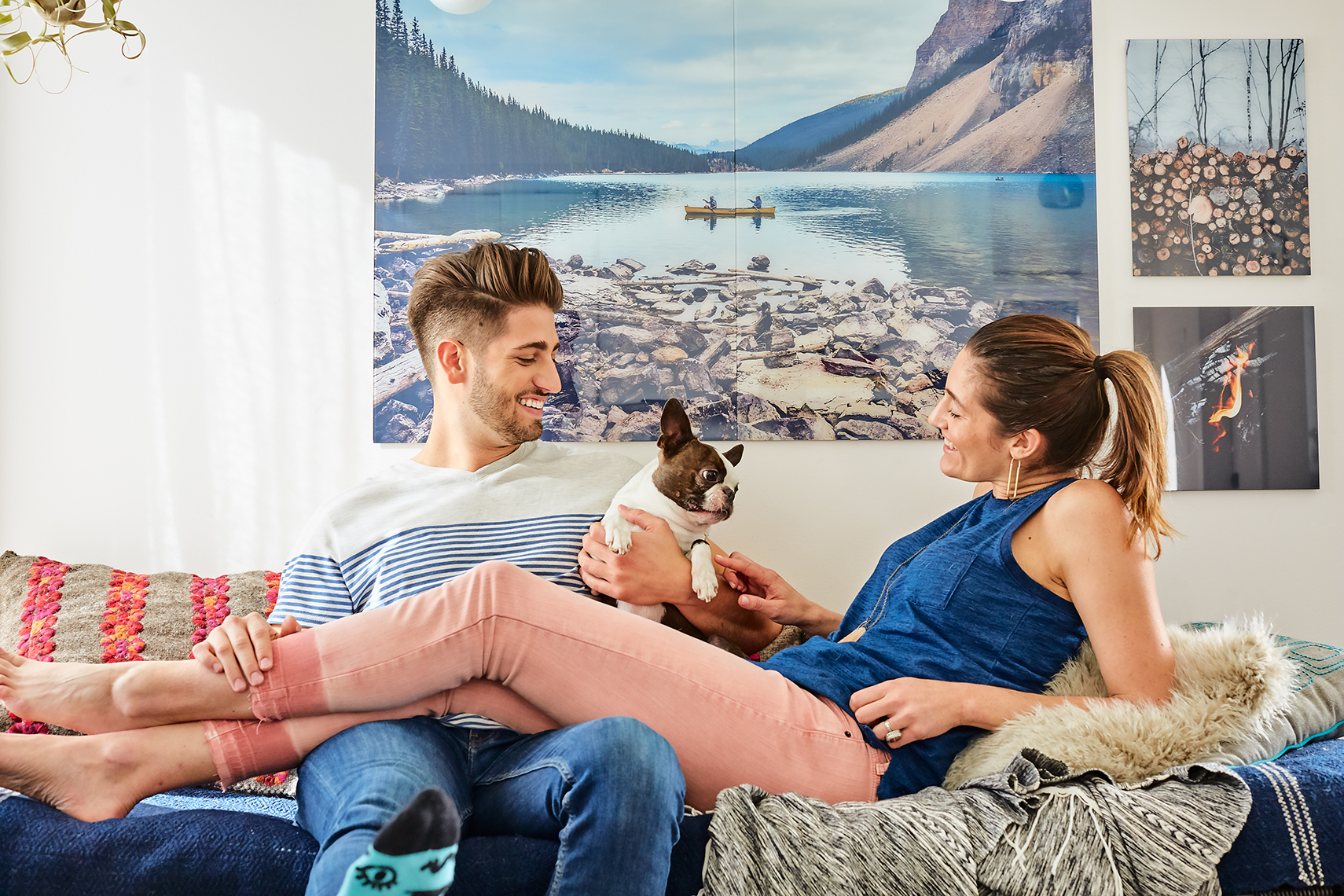 A couple hangs out on a couch in this lifestyle image by Leah Verwey