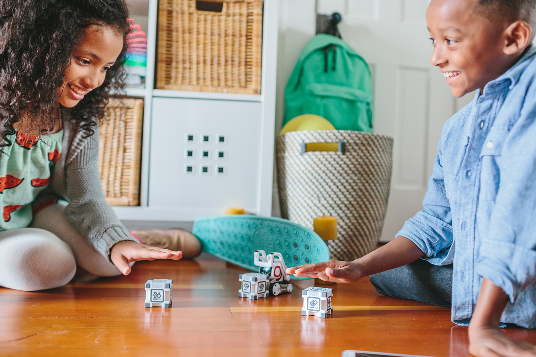 Kids play with Cozmo Robot made by toy company Anki in this lifestyle photoshoot by Leah Verwey