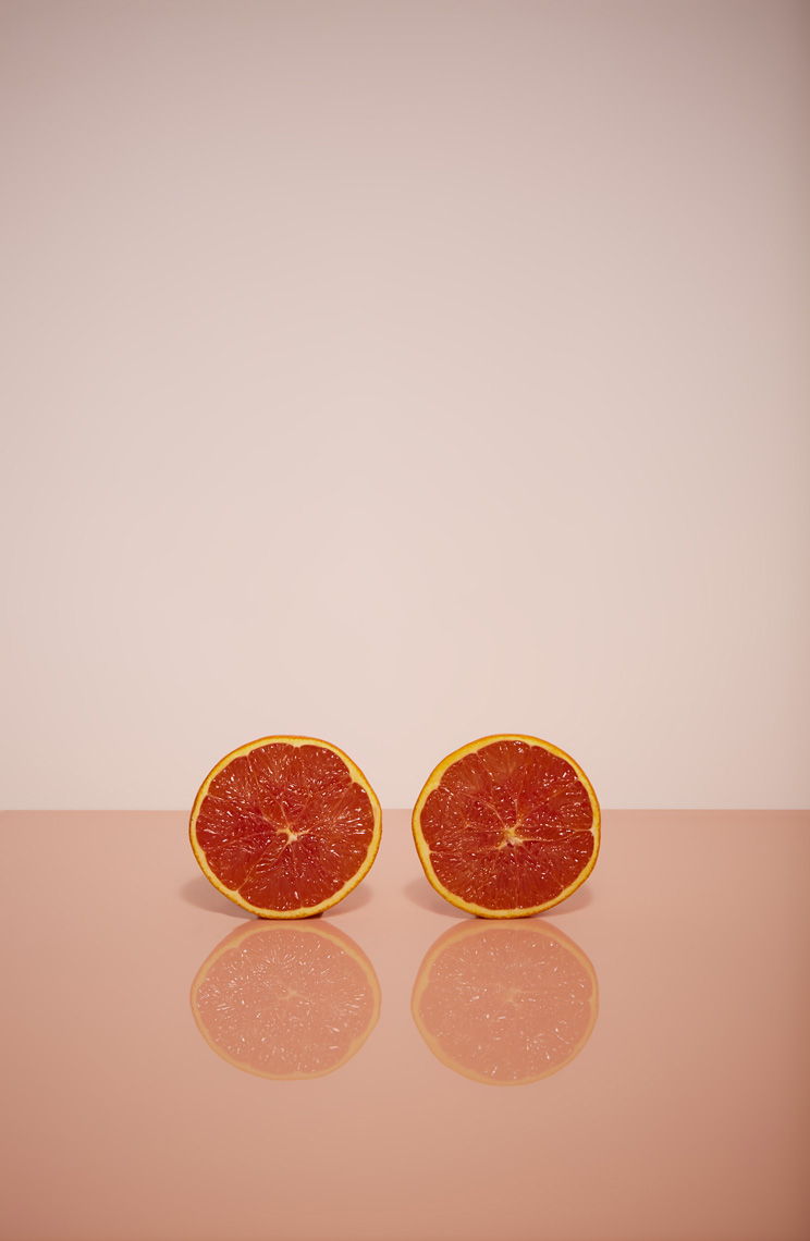 Citrus on pink, tabletop photography