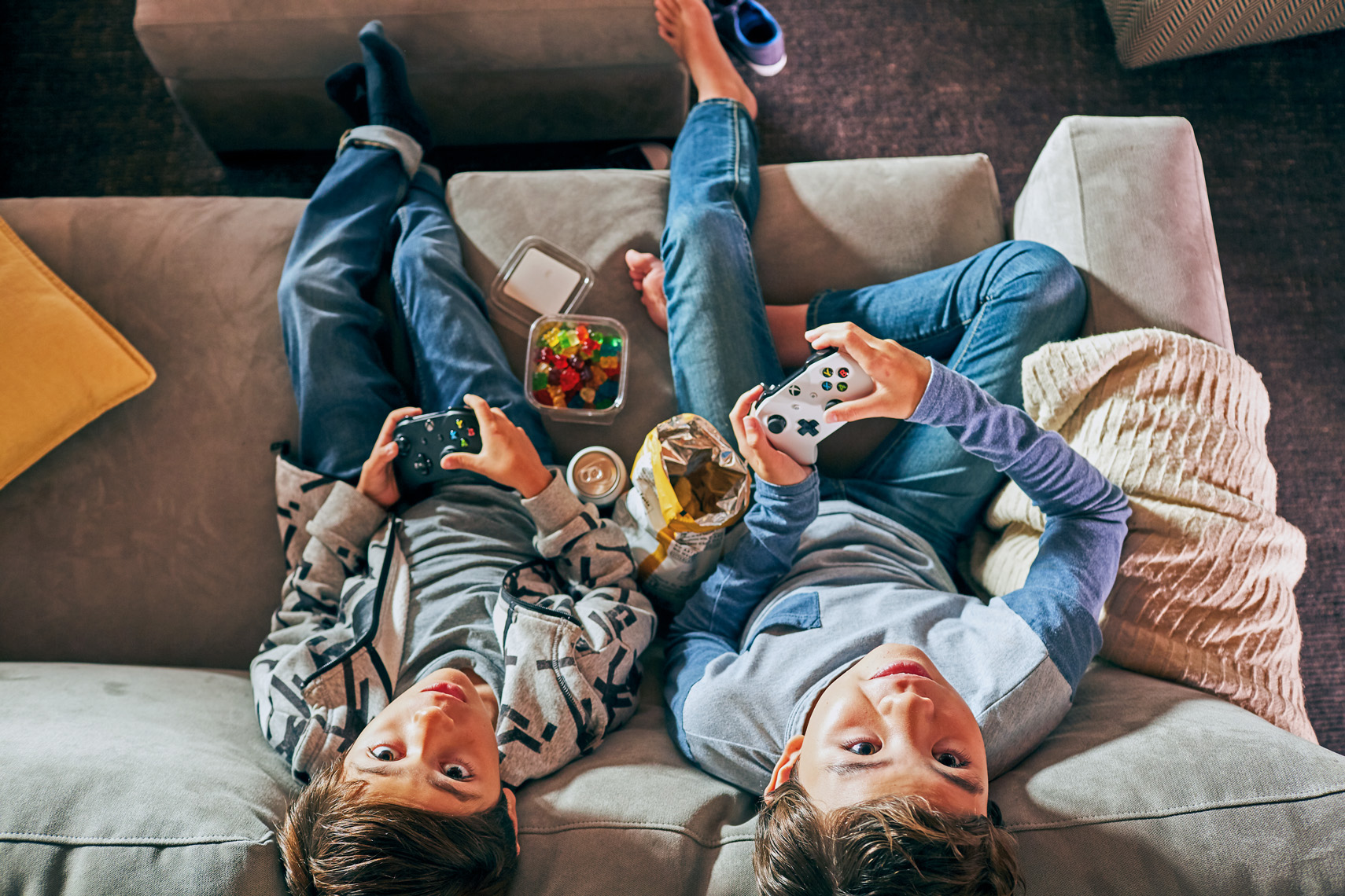 Kids pause from playing video games in this image by Leah Verwey