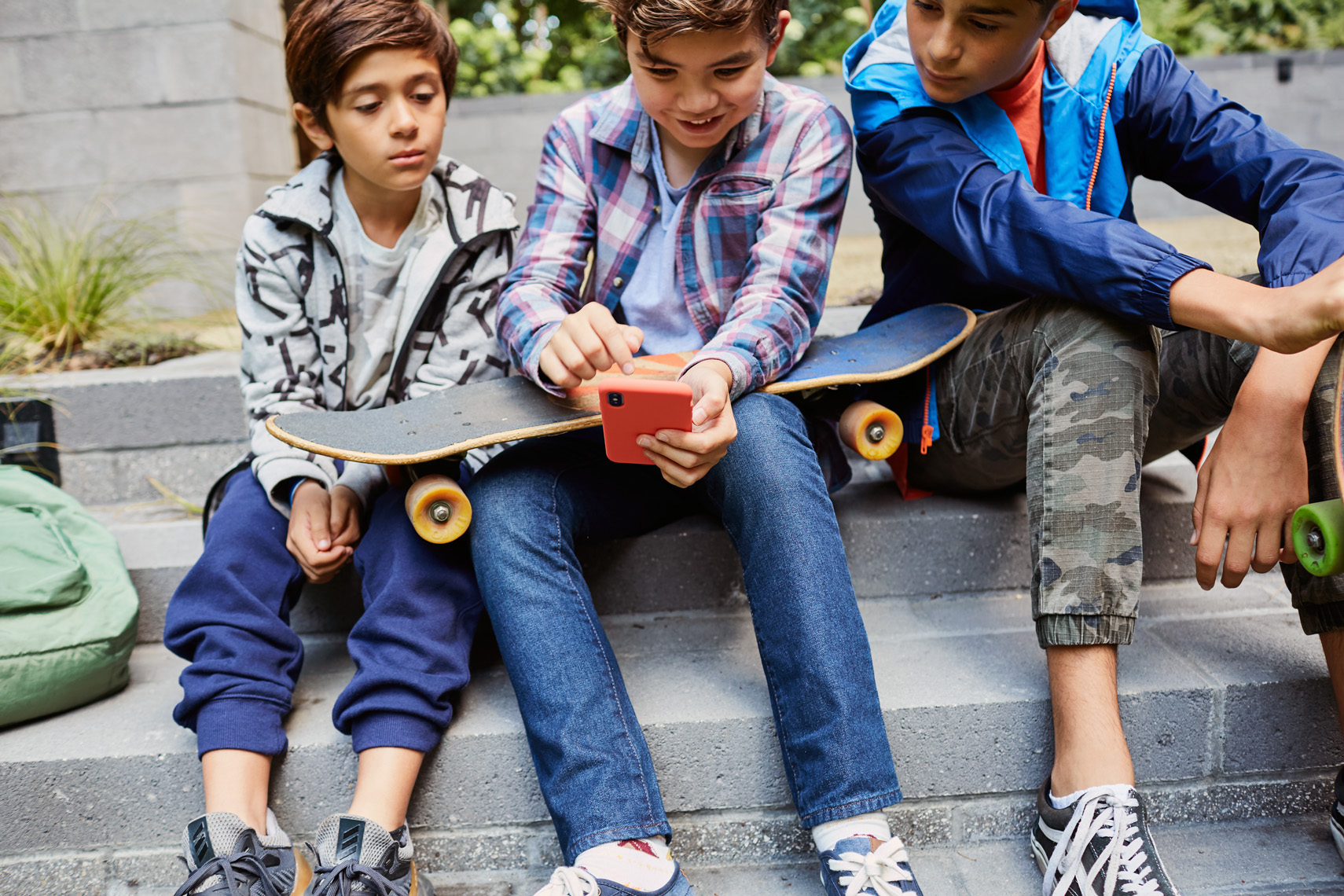 Skateboarders pause to look at a video. Image from lifestyle shoot by Leah Verwey
