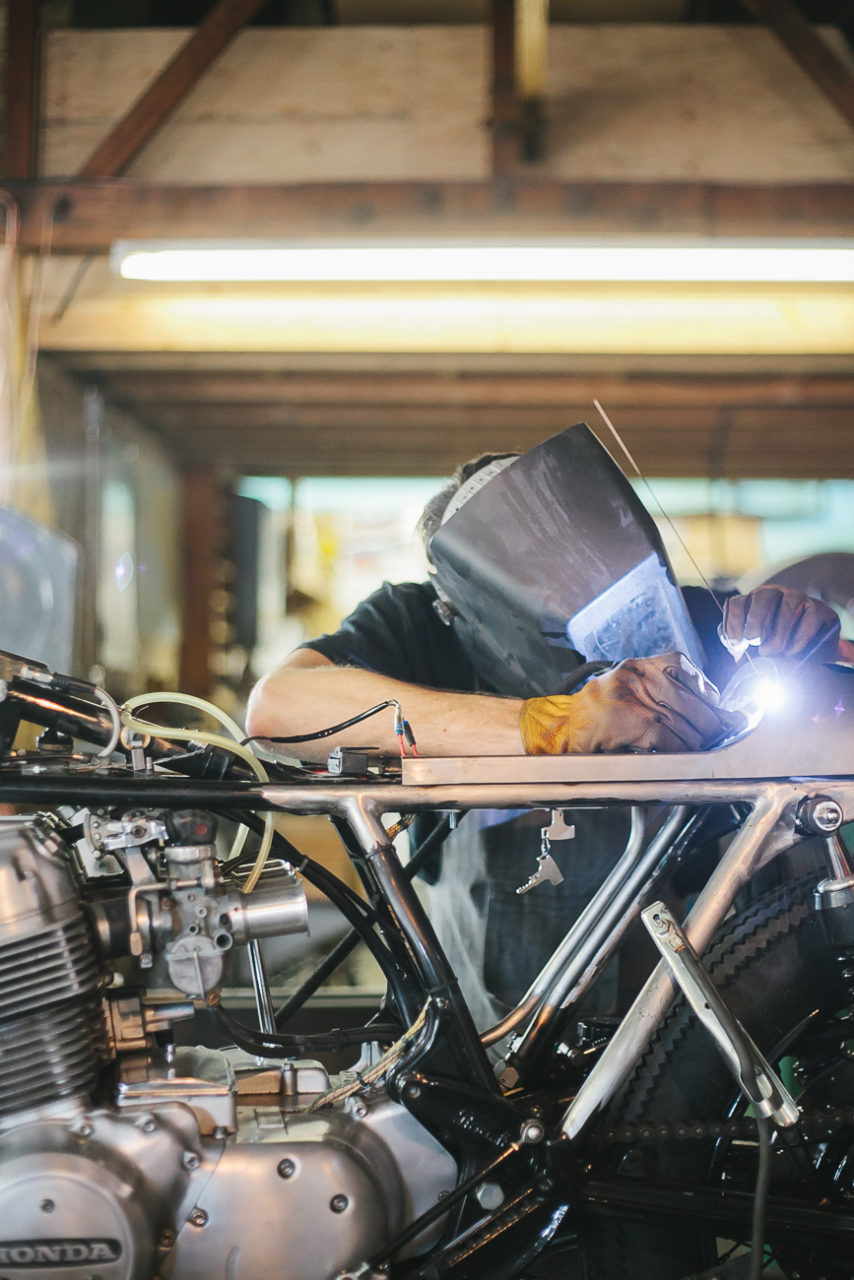 Welding a motorcycle by documentary style photographer Leah Verwey
