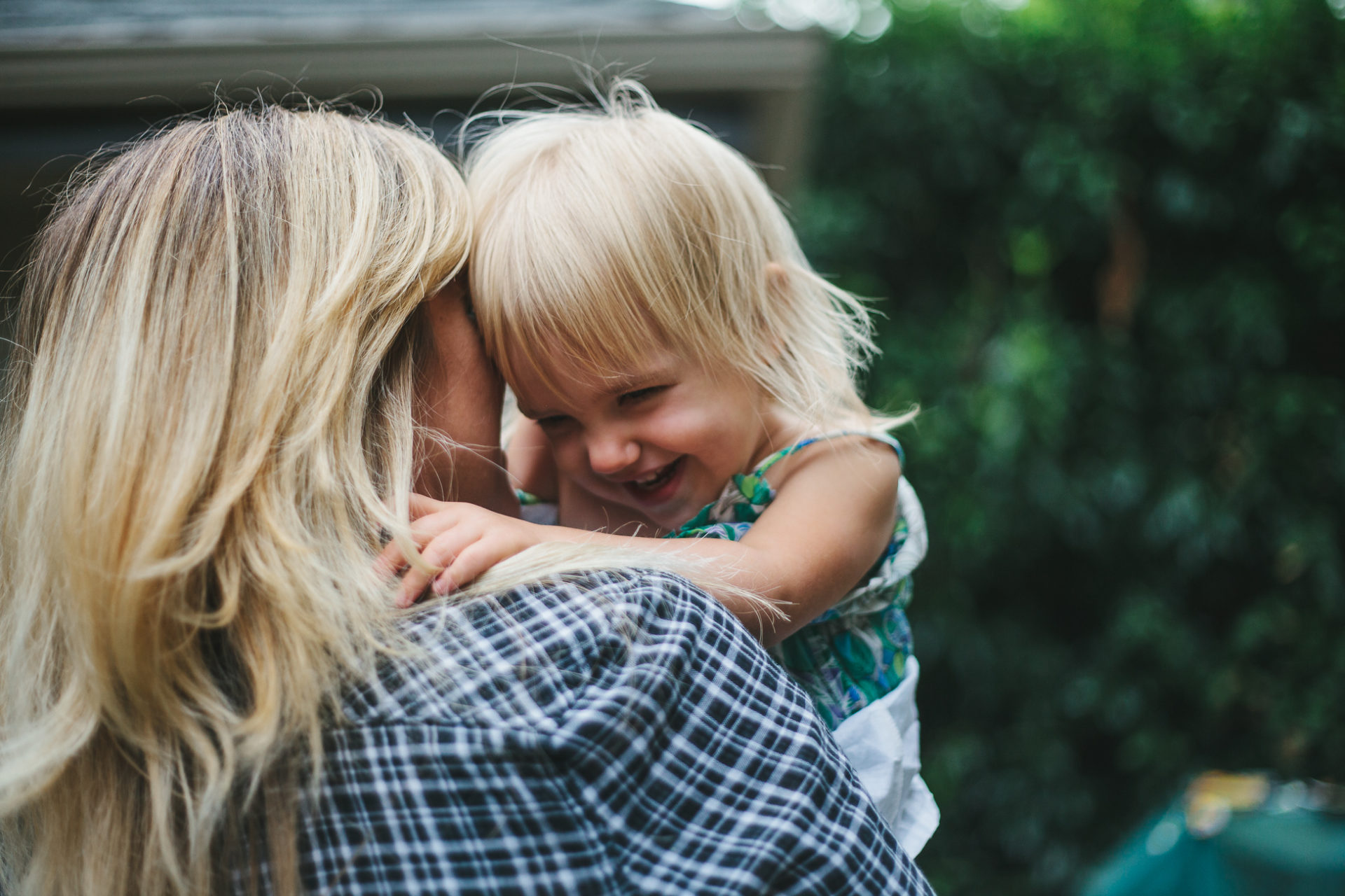 Mom snuggles daughter in a documentary style photograph | Leah Verwey Photo