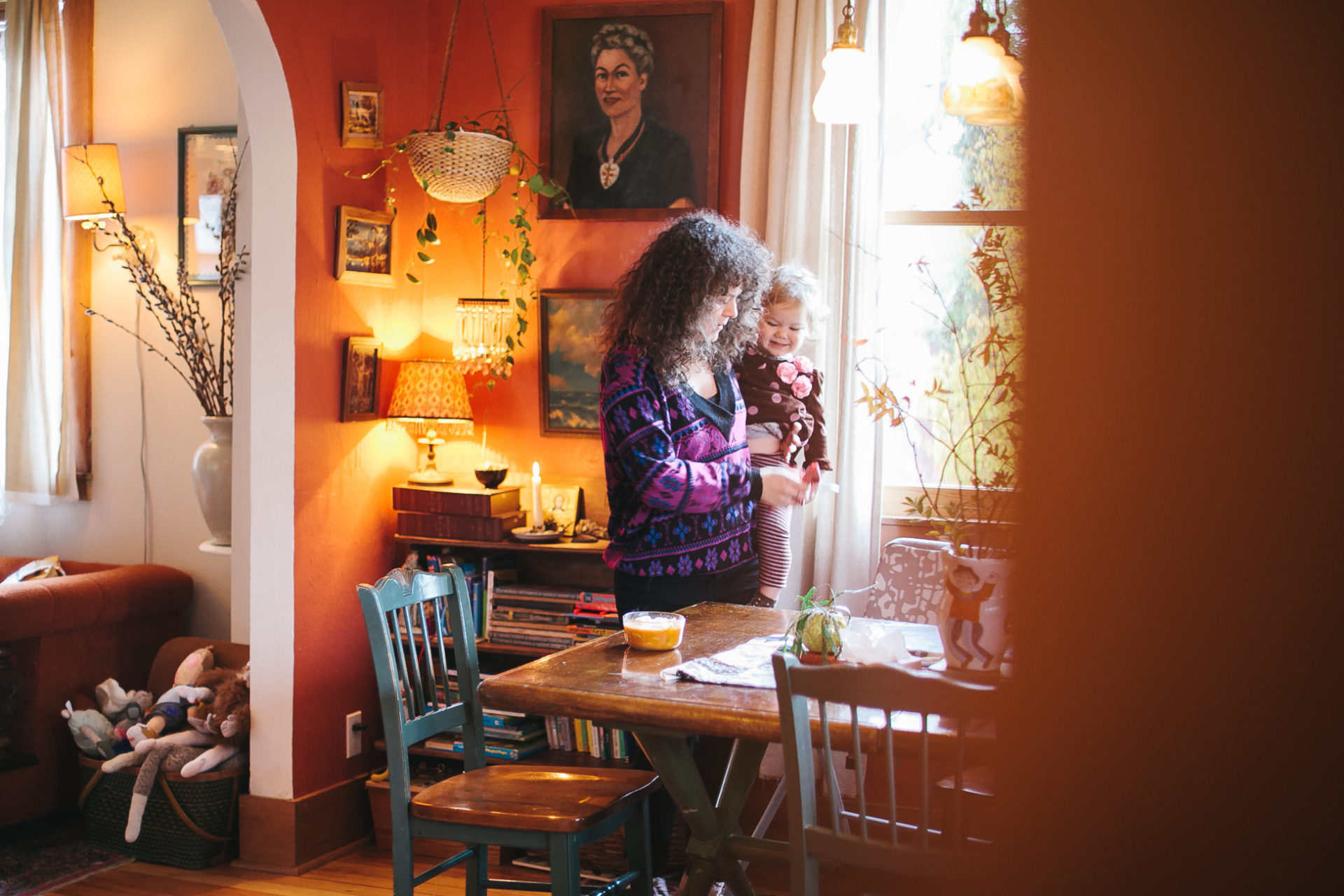 A mom preps lunch with her child in a documentary style photograph.